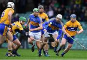 13 January 2019; Patrick Maher of Tipperary, supported by team-mate Noel McGrath, in action against Clare players, from left, Conor Cleary, David Conroy, Shane Golden, and Podge Collins during the Co-Op Superstores Munster Hurling League Final 2019 match between Clare and Tipperary at the Gaelic Grounds in Limerick. Photo by Piaras Ó Mídheach/Sportsfile