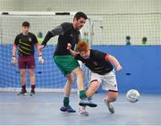 14 January 2019; Alex Fitzgerald of Caledonians in action against Niall Hogan of Dona FC during the FAI Late Nite League at Factory Youth Space, in Southill, Limerick. Photo by Seb Daly/Sportsfile