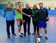14 January 2019; Captains Gary Moore of Ballynanty FC, right, and Evan Shine of Hyde Rangers, are joined by Garda Alan O'Loughlin, left, Sergeant Garda Adrian Whelan, Roxboro Road Garda Station, and Jason O'Connor, FAI Development Officer Limerick, as they shake hands prior to their match during the FAI Late Nite League at Factory Youth Space, in Southill, Limerick. Photo by Seb Daly/Sportsfile