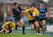 17 January 2019; Adam Bagnall of The Kings Hospital is tackled by Oliver Perrem of Newpark Comprehensive during the Bank of Ireland Vinnie Murray Cup Round 2 match between The Kings Hospital and Newpark Comprehensive at Energia Park in Dublin. Photo by Eóin Noonan/Sportsfile