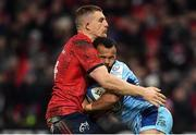 19 January 2019; Tom O'Flaherty of Exeter Chiefs is tackled by Andrew Conway of Munster during the Heineken Champions Cup Pool 2 Round 6 match between Munster and Exeter Chiefs at Thomond Park in Limerick. Photo by Brendan Moran/Sportsfile