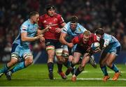 19 January 2019; Keith Earls of Munster is tackled by Jonny Hill, Sam Skinner and Santiago Cordero of Exeter Chiefs during the Heineken Champions Cup Pool 2 Round 6 match between Munster and Exeter Chiefs at Thomond Park in Limerick. Photo by Diarmuid Greene/Sportsfile