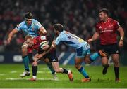 19 January 2019; Keith Earls of Munster is tackled by Sam Skinner, left, and Santiago Cordero of Exeter Chiefs during the Heineken Champions Cup Pool 2 Round 6 match between Munster and Exeter Chiefs at Thomond Park in Limerick. Photo by Diarmuid Greene/Sportsfile