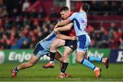 19 January 2019; Rory Scannell of Munster is tackled by Joe Simmonds, left, and Alec Hepburn of Exeter Chiefs during the Heineken Champions Cup Pool 2 Round 6 match between Munster and Exeter Chiefs at Thomond Park in Limerick. Photo by Brendan Moran/Sportsfile