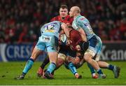 19 January 2019; CJ Stander of Munster is tackled by Ollie Devoto, Joe Simmonds and Matt Kvesic of Exeter Chiefs during the Heineken Champions Cup Pool 2 Round 6 match between Munster and Exeter Chiefs at Thomond Park in Limerick. Photo by Diarmuid Greene/Sportsfile