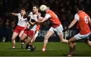 19 January 2019; Niall Sludden of Tyrone in action against Connaire Mackin of Armagh during the Bank of Ireland Dr McKenna Cup Final match between Armagh and Tyrone at the Athletic Grounds in Armagh. Photo by Oliver McVeigh/Sportsfile