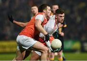 19 January 2019; Declan McClure of Tyrone in action against Brendan Donaghy of Armagh during the Bank of Ireland Dr McKenna Cup Final match between Armagh and Tyrone at the Athletic Grounds in Armagh. Photo by Oliver McVeigh/Sportsfile