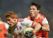 19 January 2019; Peter Harte of Tyrone  in action against James Morgan of Armagh during the Bank of Ireland Dr McKenna Cup Final match between Armagh and Tyrone at the Athletic Grounds in Armagh. Photo by Oliver McVeigh/Sportsfile