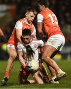 19 January 2019; Liam Rafferty of Tyrone in action against Rian O'Neill, left, and Stefan Campbell of Armagh during the Bank of Ireland Dr McKenna Cup Final match between Armagh and Tyrone at the Athletic Grounds in Armagh. Photo by Oliver McVeigh/Sportsfile