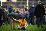 20 January 2019; Conor Keogh of Two Mile House is consoled by a supporter following the AIB GAA Football All-Ireland Intermediate Championship semi-final match between Two Mile House and Kilcummin at the Gaelic Grounds in Limerick. Photo by Eóin Noonan/Sportsfile