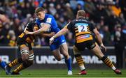 20 January 2019; Garry Ringrose of Leinster is tackled by Will Rowlands, left, and Tom Cruse of Wasps during the Heineken Champions Cup Pool 1 Round 6 match between Wasps and Leinster at the Ricoh Arena in Coventry, England. Photo by Ramsey Cardy/Sportsfile