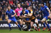 20 January 2019; Garry Ringrose of Leinster is tackled by Tom Cruse of Wasps during the Heineken Champions Cup Pool 1 Round 6 match between Wasps and Leinster at the Ricoh Arena in Coventry, England. Photo by Ramsey Cardy/Sportsfile