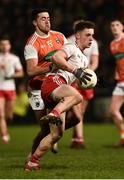 19 January 2019; Liam Rafferty of Tyrone in action against Stefan Campbell of Armagh during the Bank of Ireland Dr McKenna Cup Final match between Armagh and Tyrone at the Athletic Grounds in Armagh. Photo by Oliver McVeigh/Sportsfile