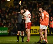 19 January 2019; Referee Joe McQuillan issues a yellow card to Conal McCann of Tyrone during the Bank of Ireland Dr McKenna Cup Final match between Armagh and Tyrone at the Athletic Grounds in Armagh. Photo by Oliver McVeigh/Sportsfile