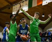 21 January 2019; Aonghus McDonnell of St Joseph's Bish, Galway, in action against Roniel Oguekwe, left, and Oisin Holland of Calasanctius College, Oranmore, during the Subway All-Ireland Schools Cup U16 A Boys Final match between Calasantius College and St Joseph's Bish Galway at the National Basketball Arena in Tallaght, Dublin. Photo by David Fitzgerald/Sportsfile