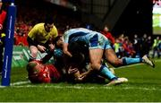 19 January 2019; Conor Murray of Munster, supported by team-mate Keith Earls, is tackled by Tom O'Flaherty and Jack Nowell of Exeter Chiefs during the Heineken Champions Cup Pool 2 Round 6 match between Munster and Exeter Chiefs at Thomond Park in Limerick. Photo by Diarmuid Greene/Sportsfile