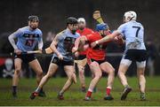 23 January 2019; Ross Donohue of UCC in action against UCD players, from left, Ronan Hayes, Sean Carey and David Fitzgerald during the Electric Ireland Fitzgibbon Cup Group A Round 2 match between University College Cork and University College Dublin at Mardyke in Cork. Photo by Stephen McCarthy/Sportsfile