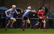 23 January 2019; Shane Conway of UCC escapes the tackle of Huw Lawlor and David Fitzgerald, left, of UCD during the Electric Ireland Fitzgibbon Cup Group A Round 2 match between University College Cork and University College Dublin at Mardyke in Cork. Photo by Stephen McCarthy/Sportsfile
