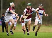 24 January 2019; Brian Concannon of N.U.I. Galway in action against Conor Cleary, left, and Kevin O'Brien of University of Limerick during the Electric Ireland Fitzgibbon Cup Group A Round 2 match between N.U.I. Galway and University of Limerick at the National University of Ireland in Galway. Photo by Harry Murphy/Sportsfile