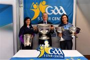 25 January 2019; David Ruddy, President IPPN President, with Aisling Doonan, LGFA, and Niamh McEvoy, Dublin ladies footballer, right, with the Liam MacCarthy, Sam Maguire, Brendan Martin and Seán O'Duffy cups at the GAA Five Star Centres stand at the Citywest Hotel Convention Centre in Saggart, Co. Dublin. Photo by Piaras Ó Mídheach/Sportsfile