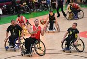 25 January 2019; Derek Hegarty of Rebel Wheelers collects a pass ahead of Mark Barry, left, and Jason Ryan of Ballybrack Bulls during the Hula Hoops IWA Cup Final match between Ballybrack Bulls and Rebel Wheelers at the National Basketball Arena in Tallaght, Dublin. Photo by Brendan Moran/Sportsfile