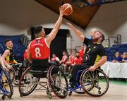 25 January 2019; Mark Barry of Ballybrack Bulls shoots over Joe Hargrow of Rebel Wheelers during the Hula Hoops IWA Cup Final match between Ballybrack Bulls and Rebel Wheelers at the National Basketball Arena in Tallaght, Dublin. Photo by Brendan Moran/Sportsfile