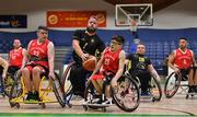 25 January 2019; Mark Barry of Ballybrack Bulls is fouled by Dylan McCarthy, left, and Conor Coughlan of Rebel Wheelers during the Hula Hoops IWA Cup Final match between Ballybrack Bulls and Rebel Wheelers at the National Basketball Arena in Tallaght, Dublin. Photo by Brendan Moran/Sportsfile