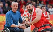 25 January 2019; Rebel Wheelers captain Paul Ryan is presented with the cup by Chairman of IWA Basketball Barry Cook after the Hula Hoops IWA Cup Final match between Ballybrack Bulls and Rebel Wheelers at the National Basketball Arena in Tallaght, Dublin. Photo by Brendan Moran/Sportsfile
