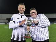 25 January 2019; Dundalk's Dane Massey is presented with the trophy by supporter Cillian Moran following his victory during the Jim Malone Cup match between Dundalk and Drogheda United at Oriel Park in Dundalk, Co. Louth. Photo by Seb Daly/Sportsfile