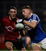 26 January 2019; Evan O'Carroll of Laois in action against Conor Francis of Down during the Allianz Football League Division 3 Round 1 match between Down and Laois at Páirc Esler in Newry, Co. Down. Photo by Oliver McVeigh/Sportsfile