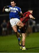 26 January 2019; Gareth Dillon of Laois  in action against Donal O'Hare of Down during the Allianz Football League Division 3 Round 1 match between Down and Laois at Páirc Esler in Newry, Co. Down. Photo by Oliver McVeigh/Sportsfile