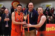 26 January 2019; Killester co-captains Alan Casey, left, and Paddy Sullivan are presented with the cup by former Ireland international Pat Burke after the Hula Hoops Men's Pat Duffy National Cup Final match between Pyrobel Killester and UCD Marian at the National Basketball Arena in Tallaght, Dublin. Photo by Brendan Moran/Sportsfile