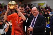 26 January 2019; Luis Filiberto Garcia Hoyos of Pyrobel Killester i spresented with the MVP by Secretary General of Basketball Ireland Bernard O'Byrne after the Hula Hoops Men's Pat Duffy National Cup Final match between Pyrobel Killester and UCD Marian at the National Basketball Arena in Tallaght, Dublin. Photo by Brendan Moran/Sportsfile