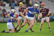 27 January 2019; Ryan Mullaney of Laois in action against Sean Bleahene, left, and Thomas Monaghan of Galway during the Allianz Hurling League Division 1B Round 1 match between Galway and Laois at Pearse Stadium in Galway. Photo by Ray Ryan/Sportsfile