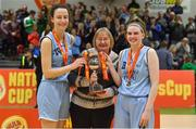 27 January 2019; DCU captains Rachel Huidjsens, left, and Bronagh Power Cassidy are presented with the cup by Grace O'Flaherty, League Administrator of the Dublin Ladies Basketball Board, after the Hula Hoops Under 20 Women's National Cup Final match between Portlaoise Panthers and DCU Mercy at the National Basketball Arena in Tallaght, Dublin. Photo by Brendan Moran/Sportsfile