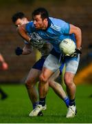 27 January 2019; Michael Darragh Macauley of Dublin is tackled by Karl O'Connell of Monaghan during the Allianz Football League Division 1 Round 1 match between Monaghan and Dublin at St Tiernach's Park in Clones, Co. Monaghan. Photo by Ramsey Cardy/Sportsfile