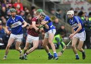 27 January 2019; Padraic Mannion of Galway in action against Aaron Dunphy, left, Paddy Purcell, centre, and Eanna Lyons of Laois during the Allianz Hurling League Division 1B Round 1 match between Galway and Laois at Pearse Stadium in Galway. Photo by Ray Ryan/Sportsfile