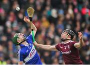 27 January 2019; Aaron Dunphy of Laois in action against Sean Linnane of Galway during the Allianz Hurling League Division 1B Round 1 match between Galway and Laois at Pearse Stadium in Galway. Photo by Ray Ryan/Sportsfile