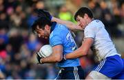 27 January 2019; Michael Darragh Macauley of Dublin is tackled by Darren Hughes of Monaghan during the Allianz Football League Division 1 Round 1 match between Monaghan and Dublin at St Tiernach's Park in Clones, Co. Monaghan. Photo by Ramsey Cardy/Sportsfile