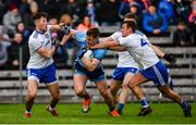 27 January 2019; John Small of Dublin is tackled by Dessie Ward, left, Conor McCarthy, centre, and Ryan Wylie of Monaghan during the Allianz Football League Division 1 Round 1 match between Monaghan and Dublin at St Tiernach's Park in Clones, Co. Monaghan. Photo by Ramsey Cardy/Sportsfile