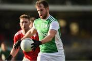 27 January 2019; Sean Quigley of Fermanagh in action against Kevin Flahive of Cork during the Allianz Football League Division 2 Round 1 match between Fermanagh and Cork at Brewster Park in Enniskillen, Fermanagh. Photo by Oliver McVeigh/Sportsfile
