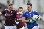 27 January 2019; Conor Madden of Cavan in action against Sean Andy O'Ceallaigh of Galway during the Allianz Football League Division 1 Round 1 match between Galway and Cavan at Pearse Stadium in Galway. Photo by Ray Ryan/Sportsfile