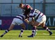 30 January 2019; Henry O'Hagan of Wesley College is tackled by Ryan McMahon, left, and Joe Carroll of Clongowes Wood College during the Bank of Ireland Leinster Schools Senior Cup Round 1 match between Wesley College and Clongowes Wood College at Energia Park in Dublin. Photo by Ben McShane/Sportsfile