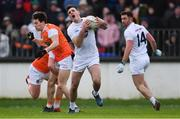 27 January 2019; Eoin Doyle of Kildare gets past Ryan McShane, behind, and James Morgan of Armagh as team-mate Ben McCormack looks on during the Allianz Football League Division 2 Round 1 match between Kildare and Armagh at St Conleth's Park in Newbridge, Kildare. Photo by Piaras Ó Mídheach/Sportsfile
