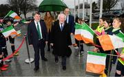 31 January 2019; President Michael D Higgins accompanied by FAI President Donal Conway, left, and FAI Director of Competitions Fran Gavin, right, arrives for a visit to the FAI Headquarters in Abbottstown, Dublin. Photo by Stephen McCarthy/Sportsfile