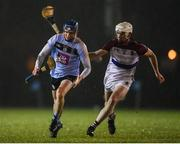 31 January 2019; Rory Percell of UCD in action against Michael Carey of UL during the Electric Ireland Fitzgibbon Cup Group A Round 3 match between University College Dublin and University of Limerick at Billings Park in Belfield, Dublin. Photo by Stephen McCarthy/Sportsfile