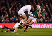 2 February 2019; Robbie Henshaw of Ireland is tackled by Ben Youngs and Jonny May of England during the Guinness Six Nations Rugby Championship match between Ireland and England in the Aviva Stadium in Dublin. Photo by Ramsey Cardy/Sportsfile