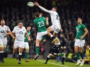 2 February 2019; Jonny May of England keeps the ball in-play ahead of Jordan Larmour of Ireland during the Guinness Six Nations Rugby Championship match between Ireland and England in the Aviva Stadium in Dublin. Photo by Brendan Moran/Sportsfile