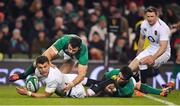 2 February 2019; Henry Slade of England is tackled by /Robbie Henshaw and Joey Carbery of Ireland during the Guinness Six Nations Rugby Championship match between Ireland and England in the Aviva Stadium in Dublin. Photo by Brendan Moran/Sportsfile