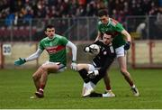 3 February 2019; Niall Morgan of Tyrone caught in possession out field by Jason Doherty and Fionn McDonagh of Mayo during the Allianz Football League Division 1 Round 2 match between Tyrone and Mayo at Healy Park in Omagh, Tyrone. Photo by Oliver McVeigh/Sportsfile